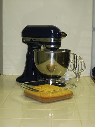 it\'s hard to see the corn bread over the gleam of the kitchen aid